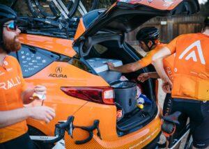 #119, Pro cycling teams rely on team cars' assistance 2