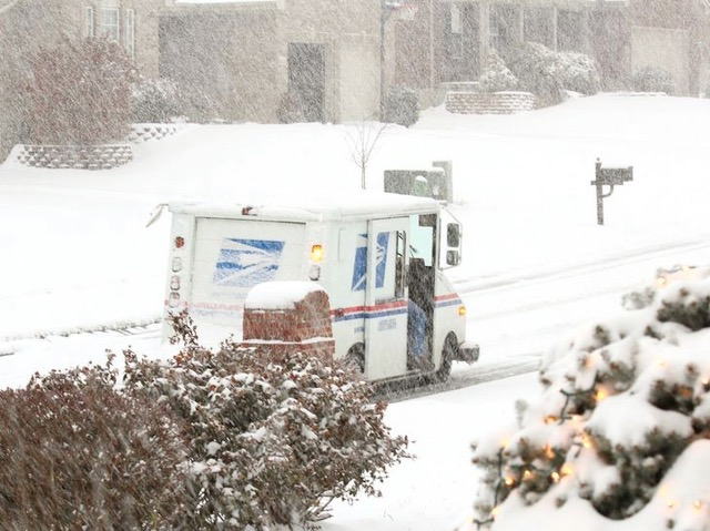 The U.S. Postal Service delivers thr mail despite inclement weather.