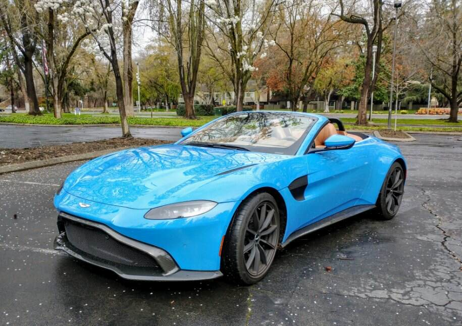 The 2021 Aston Martin Vantage attracts attention with its combined blue exterior and tan interior.