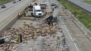 Freeways can be full of degris like frozen pizzas, bees, spilled milk and money