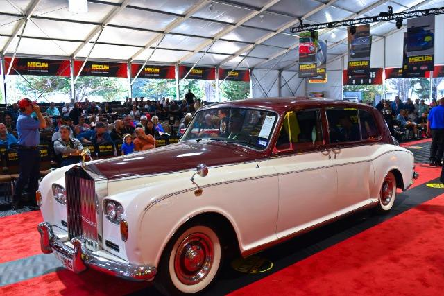 A vintage Rolls-Royce on the carpet during the Mecum Auctions three-day sale in Monterey Auto Week.