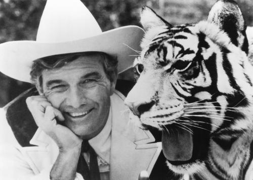 "Car dealer Cal Worthington and one of his many animals named ""Spot."""