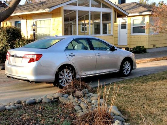 The 2014 Toyota Camry has a clean side profile.