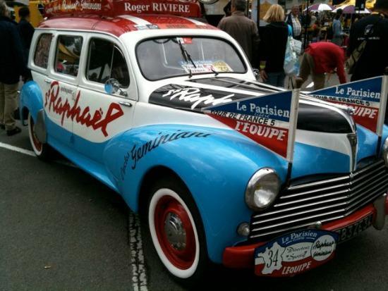A vintage team car from the Tour de France.