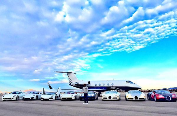 Floyd Mayweather with his jet and car collection.