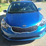 "The 2012 Kia Forte new designed includes the Kia signature ""smiling"" grille."