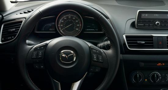 The 2014 Mazda3 interior is clean and functional.