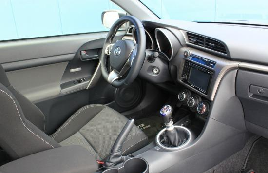The interior of the 2014 Scion tC has a race car resemblance.