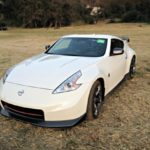 The 2014 Nissan 370Z has long headlamps, which extend onto the hood.