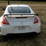 The 2014 Nissan 370Z has a rear spoiler It impedes the driver's rear view.