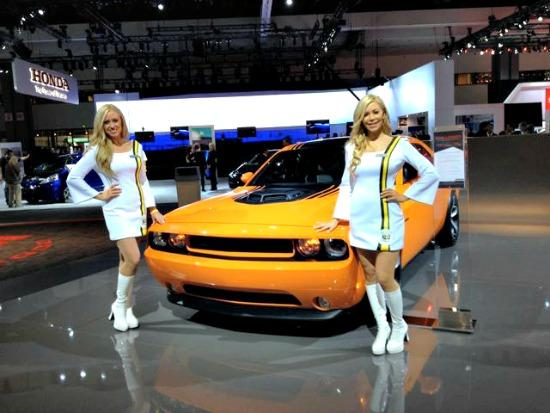 Two product specialists showcasing the Dodge Challenger at the LA Auto Show.